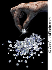 Diamonds on black surface and hand