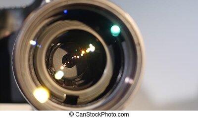 Diaphragm of a camera lens aperture, close up, open, glare...