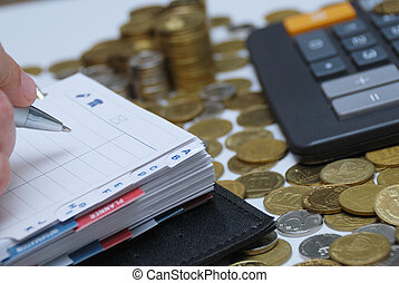 Diary and money - Business concept - diary, coins and ...