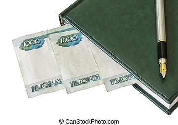 Diary, fountain pen and Russian rubles on a light background