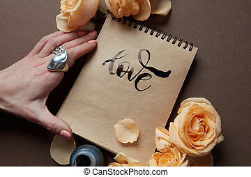 Diary or notebook with word love - Closeup of diary or ...