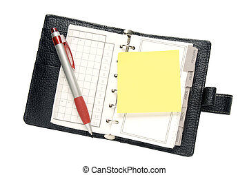 Diary Planner - A dairy planner with a yellow sticky note...