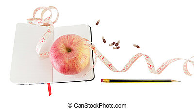 Diary with apple and pills for effective dieting