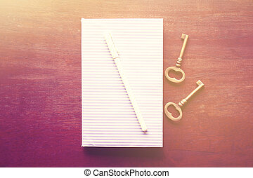Diary with pen and keys, vintage color effect