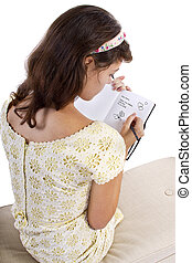 Diary - young female writing on a retro style diary with ...