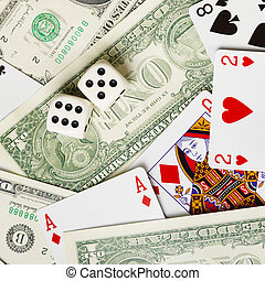 Dice are on money and cards
