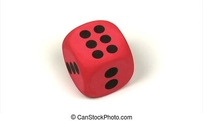 Dice - Big red dice on a rotating platform