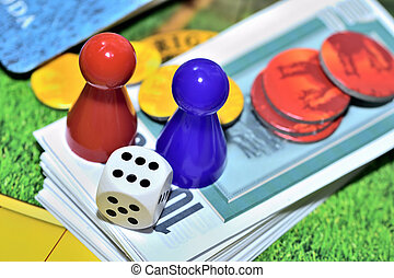 Dice, blue, red figures, chips and game money on the board.