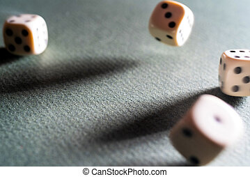 Dice game. Dice on the table. Illuminated with a contrasting light. Long shadows on the diagonal.