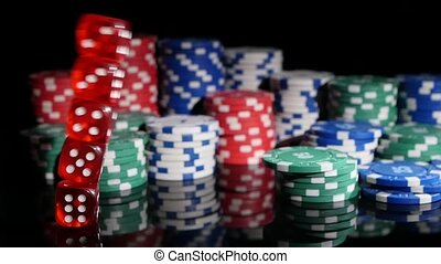Dice game falling on the background of poker chips. Slow motion.