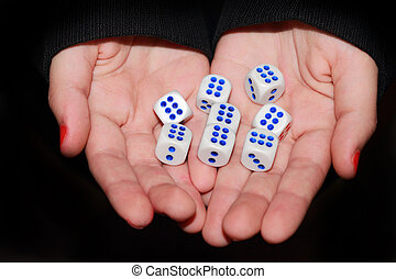 dice in his hands