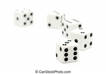 dice macro, highkey over white with focus on front dice. shallow depth of field.