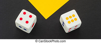Dice on a black and yellow background, close-up