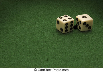 Dice on a green felt gambling table. Horizontal