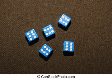 Dice on the table. Poker game.
