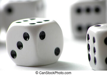 Dice on white table - a close-up