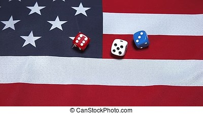 Dice rolling on American Flag, slow motion 4K