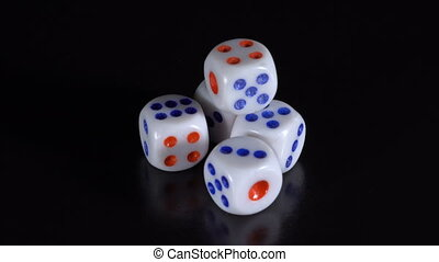 Dice rotate on a black table