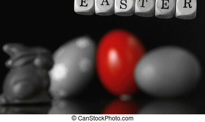 Dice spelling out easter falling in