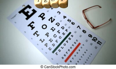 Dice spelling out eye test falling