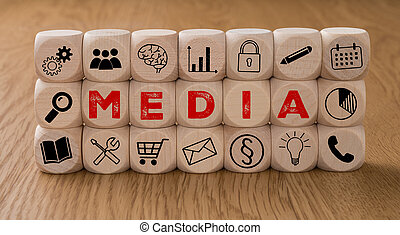 Dice with icons and the word Media