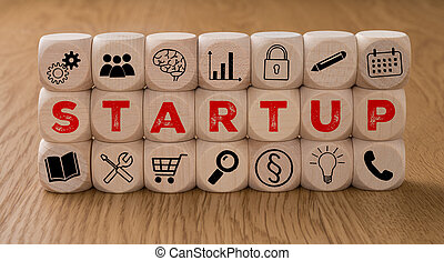 Dice with icons and the word Startup