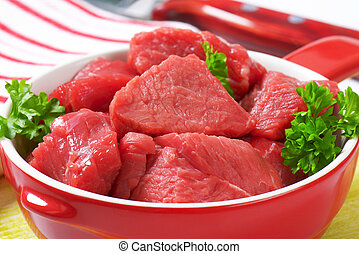 Diced beef - Raw diced beef in a pan