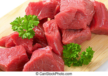 Diced beef - Raw diced beef on cutting board