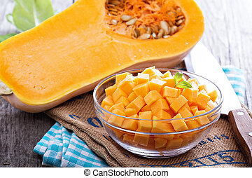 Diced butternut squash in a bowl ready for cooking