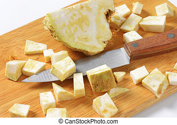 Diced celery root on cutting board