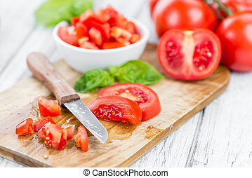 Diced Tomatoes (selective focus) on vintage wooden...