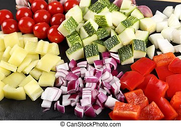 Diced vegetables. - Colored peppers and onions diced on a ...