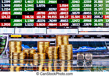 Dices cubes with the words SELL BUY, columns of golden coins and financial charts as background. Selective focus