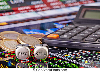Dices cubes with words SELL BUY for trader, euro coins and calculator. Financial chart as background. Selective focus