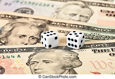 Dices on money background - business concept