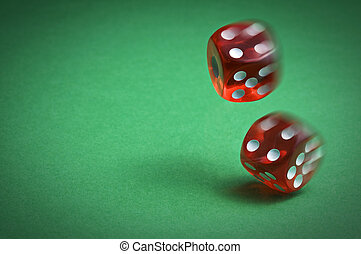 Dices - Red dices in midair on green background close up