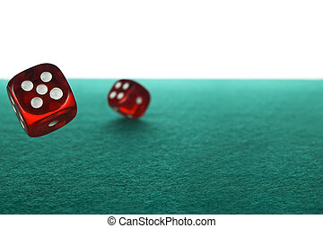 Dices rolling - Two red dices rolling over a green felt ...
