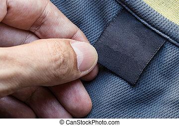 dichtbegroeid boven, hand, houden, kleding, etiket