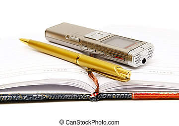 Dictaphone, notepad and ballpen on white background...