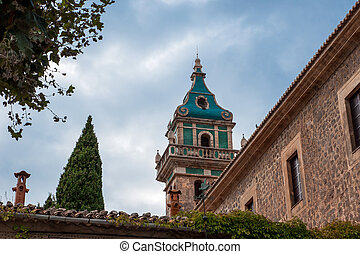 View of the tower of the famous Charterhouse of Valldemossa, Mallorca, Spain