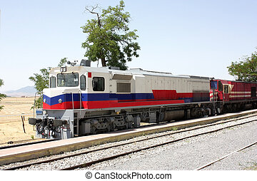 Diesel locomotives - Two diesel locomotives in the station. ...