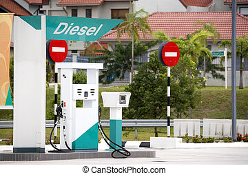 Image of a diesel pump at a gas station.