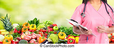 Diet and health care. - Medical doctor woman over Diet and...