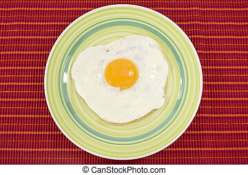 green plate with cooked egg