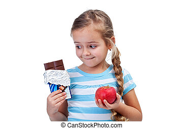 Healthy diet choices - little girl with apple and chocolate