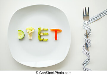 Diet. Close up of plate with vegetable diet letters