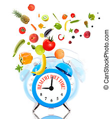 Diet concept, alarm clock ringing and fruits with vegetables.