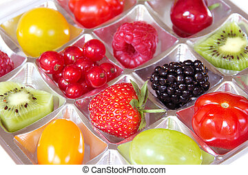 Diet concept - different fresh fruits in a chocolate box