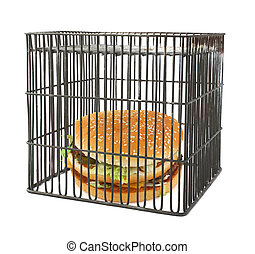 diet concept - fast food behind bars, natural shadow underneath