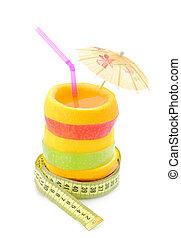 Diet concept. Fruit juice with measure tape